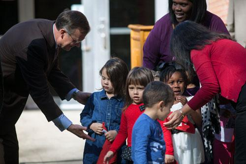 President Ransdell with children and staff from the Center